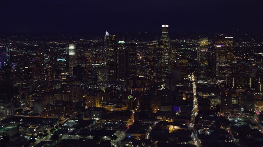 8K aerial video of skyscrapers at night while flying by Downtown Los Angeles, California Aerial Stock Footage | AX0158_095