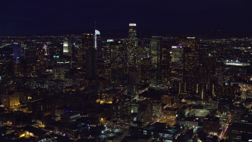 8K stock footage aerial video of skyscrapers at night in Downtown Los Angeles, California Aerial Stock Footage | AX0158_096