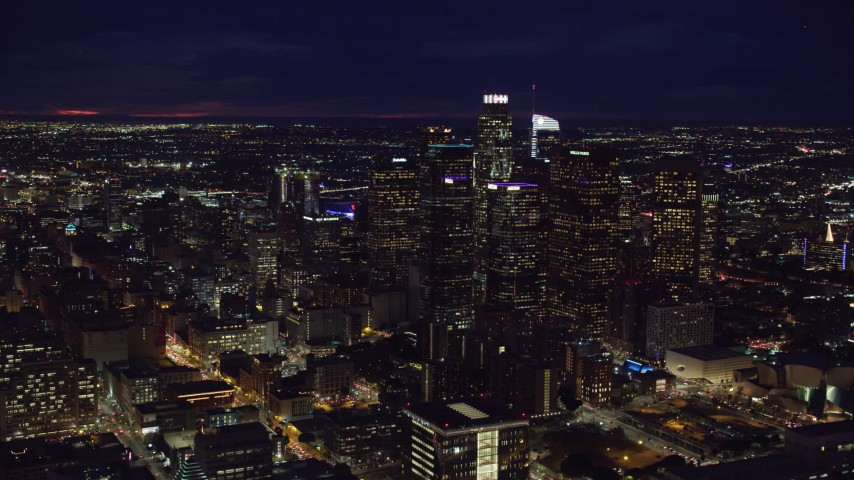 8K stock footage aerial video of group of skyscrapers at night in Downtown Los Angeles, California Aerial Stock Footage | AX0158_097