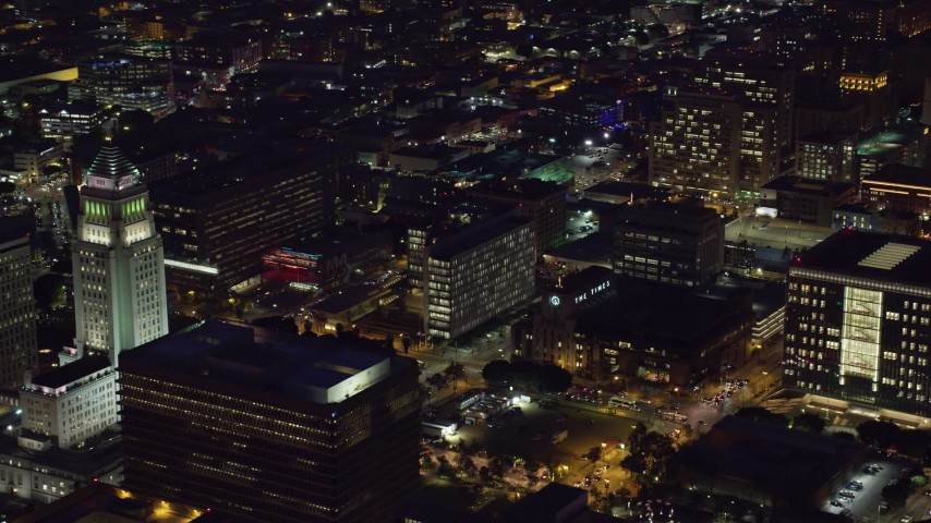 8K stock footage aerial video of City Hall, LAPD Headquarters, LA Times building at night, Downtown Los Angeles, California Aerial Stock Footage | AX0158_098