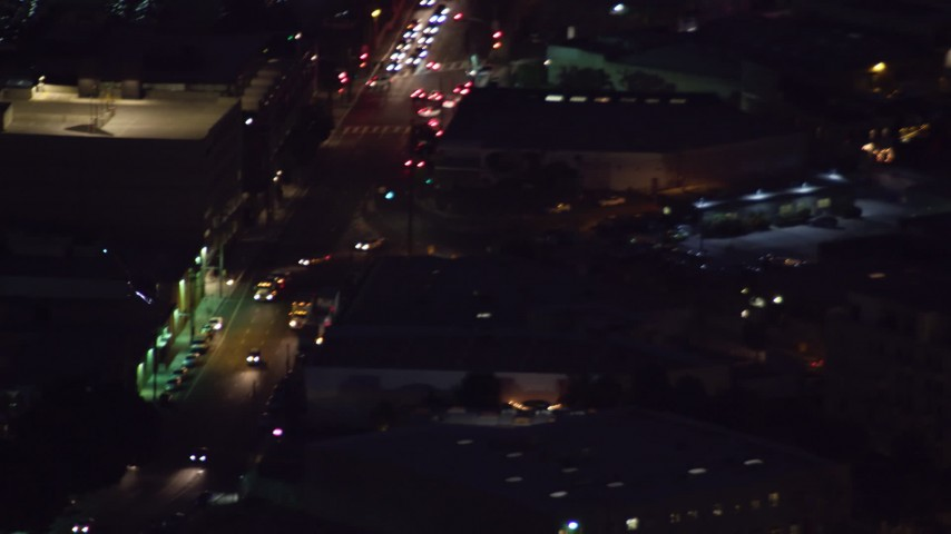 8K stock footage aerial video of an LAPD helicopter flying over Downtown Los Angeles, California at night Aerial Stock Footage | AX0158_099
