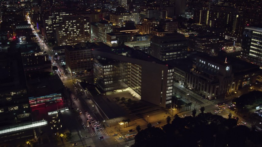8K stock footage aerial video flying by City Hall and approach LAPD headquarters at night in Downtown Los Angeles, California Aerial Stock Footage AX0158_103 | Axiom Images