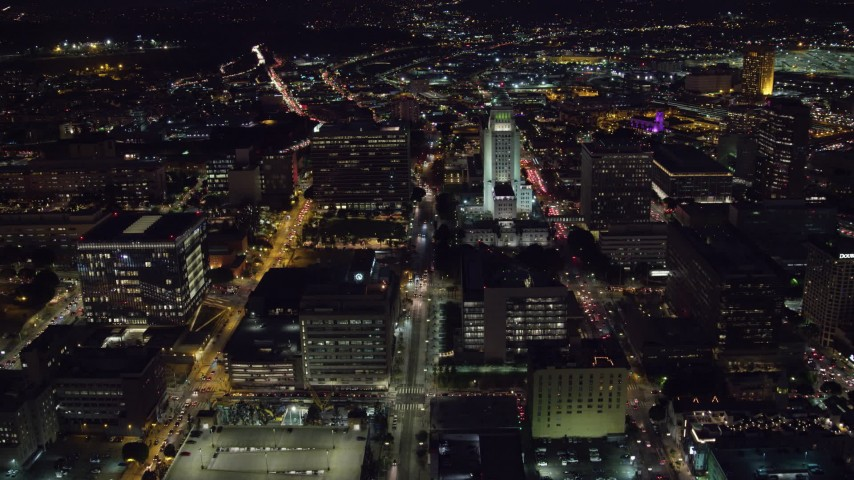 8K stock footage aerial video of a reverse view of Los Angeles City Hall at night in Downtown Los Angeles, California Aerial Stock Footage | AX0158_105