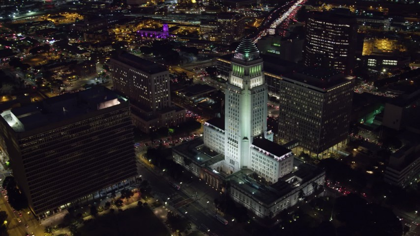 8K stock footage aerial video approaching and flying by Los Angeles City Hall at night in Downtown Los Angeles, California Aerial Stock Footage | AX0158_106