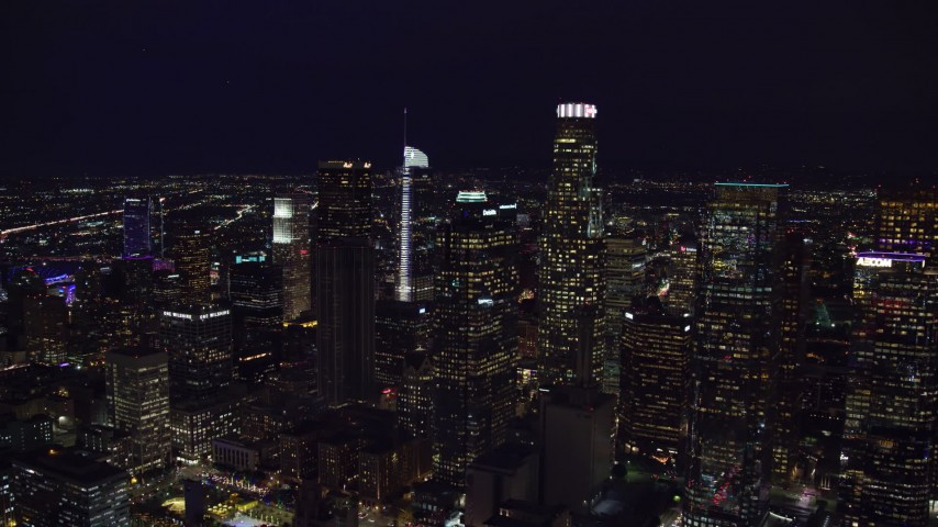 8K stock footage aerial video approaching skyscrapers at night in Downtown Los Angeles, California Aerial Stock Footage | AX0158_110