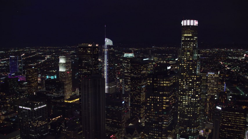 8K stock footage aerial video of Aon Center to reveal Wilshire Grand Center at night, Downtown Los Angeles, California Aerial Stock Footage | AX0158_111