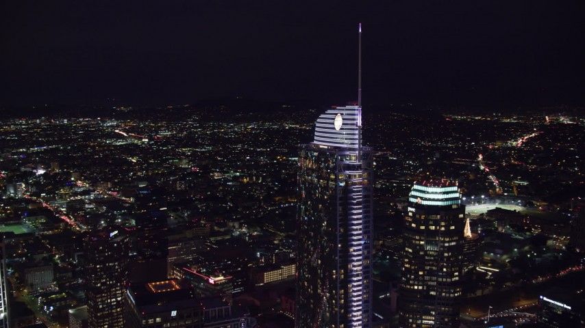 8K aerial video orbiting Wilshire Grand Center at night in Downtown Los Angeles, California Aerial Stock Footage | AX0158_112
