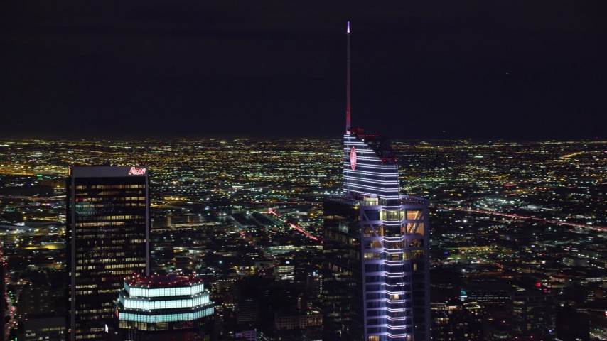 8K stock footage aerial video orbiting of the Wilshire Grand Center tower at night in Downtown Los Angeles, California Aerial Stock Footage | AX0158_114