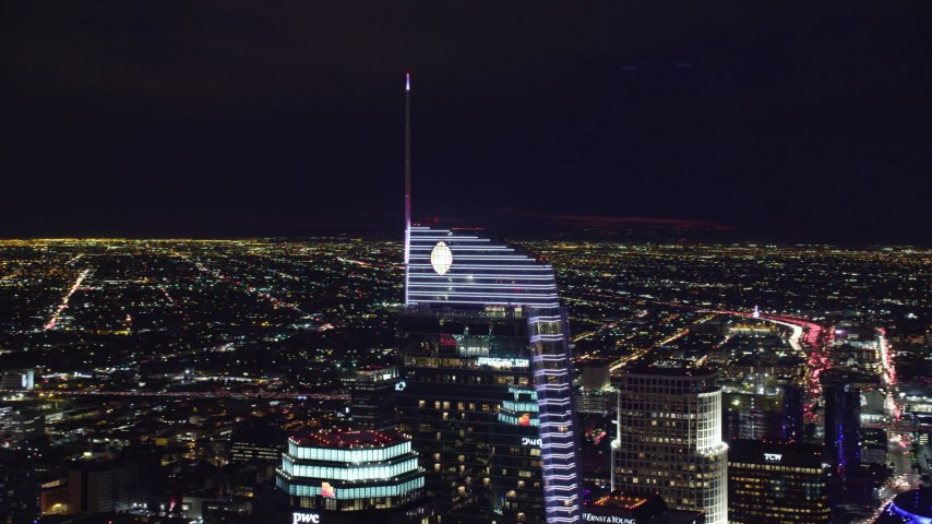 8K stock footage aerial video orbiting the top of the Wilshire Grand Center tower at night, Downtown Los Angeles, California Aerial Stock Footage | AX0158_115