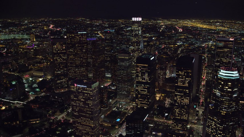 8K aerial video flying by skyscrapers at night, and approach US Bank Tower, Downtown Los Angeles, California Aerial Stock Footage | AX0158_120