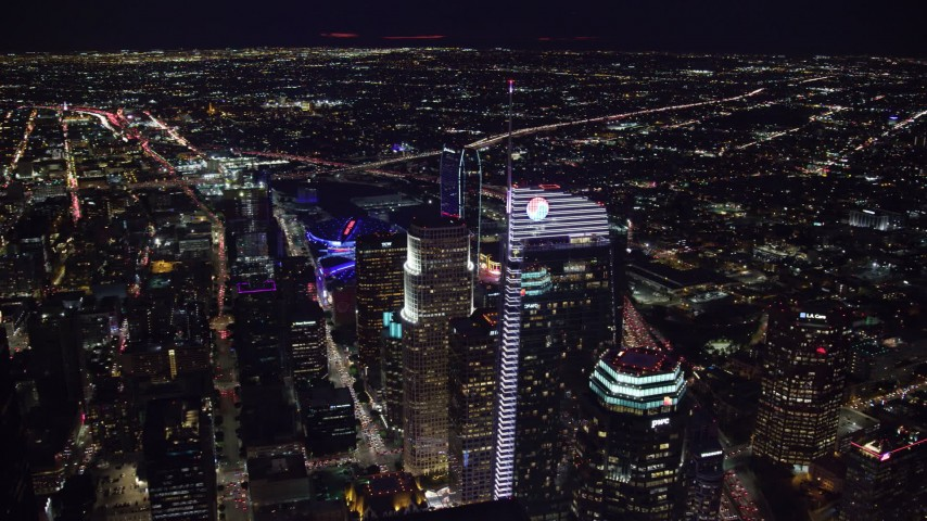 8K aerial video flying by and approaching Wilshire Grand Center at night in Downtown Los Angeles, California Aerial Stock Footage AX0158_121