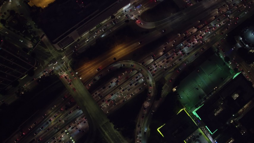 8K stock footage aerial video of a bird's eye view of heavy nighttime traffic on the 110 Freeway, Downtown Los Angeles, California Aerial Stock Footage | AX0158_124