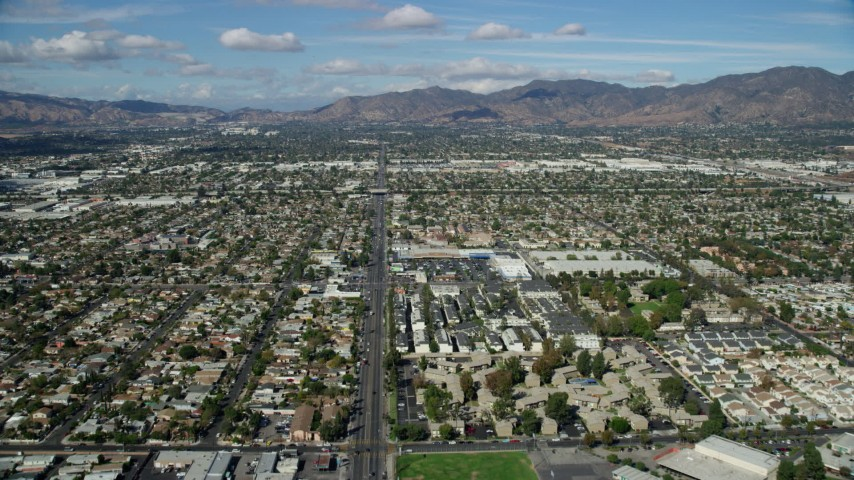 8K stock footage aerial video flying over suburban neighborhoods, Pacoima, San Fernando Valley, California Aerial Stock Footage | AX0159_001
