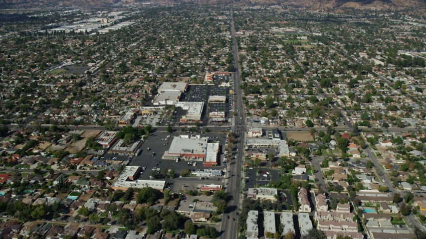 8K aerial video flying over Glenoaks Blvd and shopping centers, Sylmar, California Aerial Stock Footage | AX0159_004