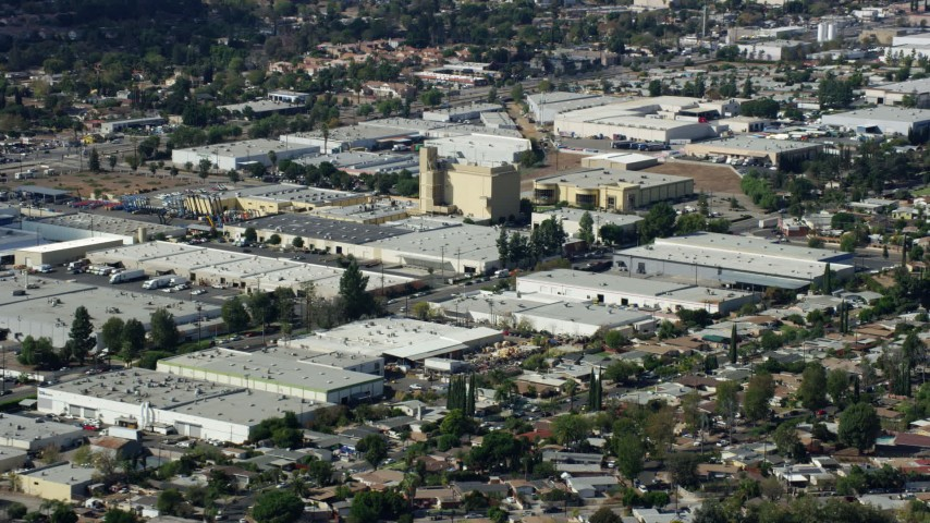 8K stock footage aerial video of warehouses, San Fernando Valley, Sylmar, California Aerial Stock Footage | AX0159_005