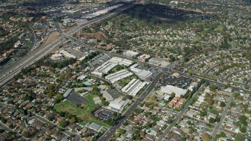 8K stock footage aerial video of Wiley Canyon Elementary School, storage facilities and retail spaces, Santa Clarita, California Aerial Stock Footage | AX0159_013