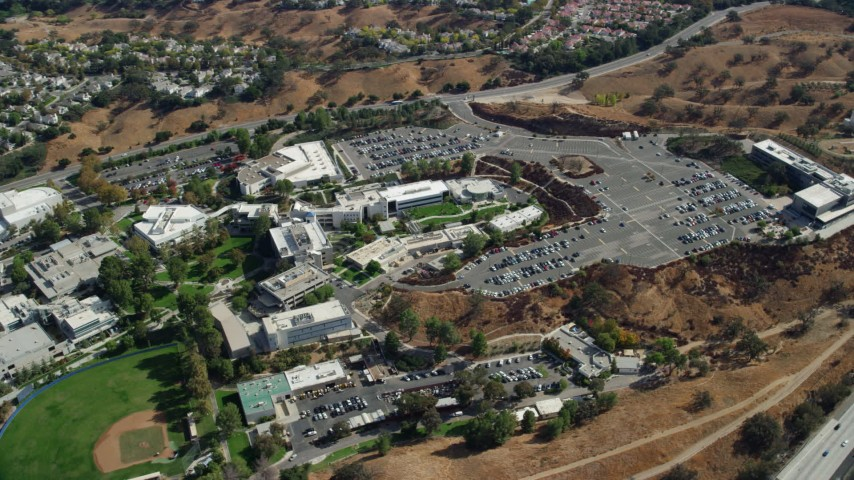 8K stock footage aerial video orbiting away from College of the Canyons campus, Santa Clarita, California Aerial Stock Footage | AX0159_016