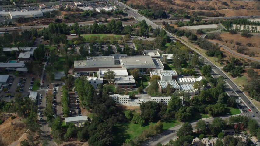 8K stock footage aerial video orbiting College Institute of the Arts campus, Santa Clarita, California Aerial Stock Footage | AX0159_017