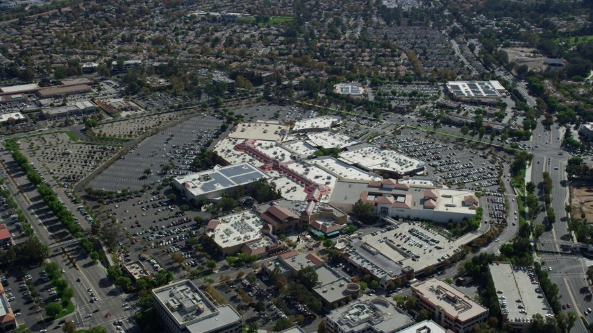 8K stock footage aerial video orbiting a shopping mall and parking lot, Santa Clarita, California Aerial Stock Footage | AX0159_026
