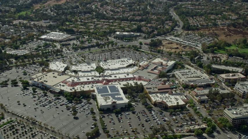 8K stock footage aerial video of a high orbit of a shopping mall, Santa Clarita, California Aerial Stock Footage | AX0159_027