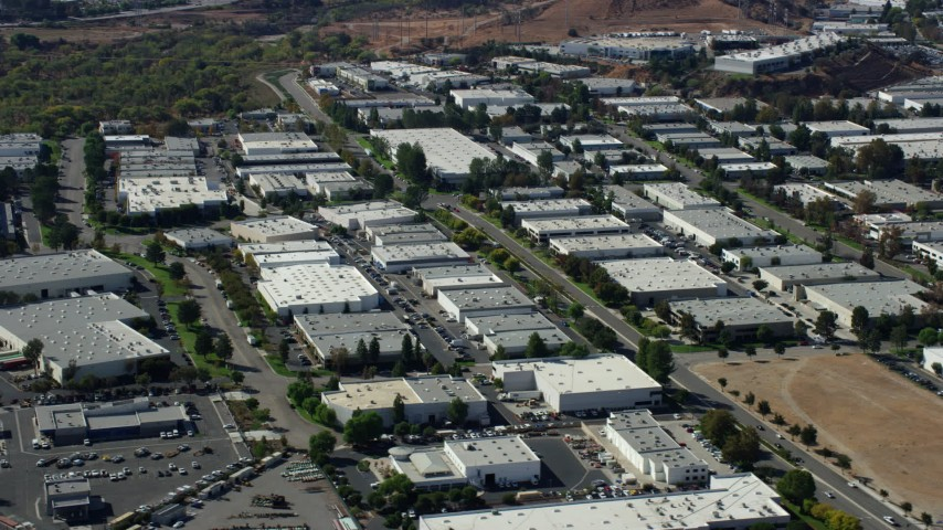8K stock footage aerial video of rows of office buildings and warehouses, Valencia, California Aerial Stock Footage | AX0159_035