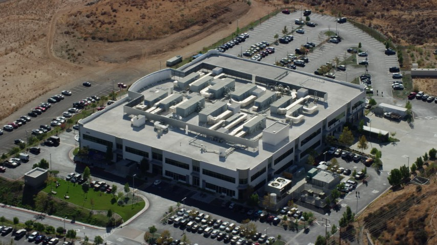 8K aerial video orbiting a tech office building, Valencia, California Aerial Stock Footage | AX0159_038