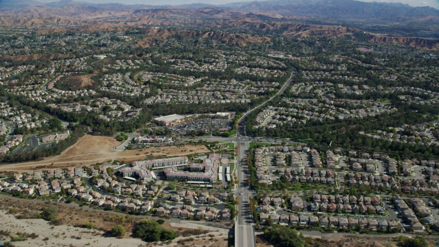 8K aerial video flying over tract homes, Valencia, California Aerial Stock Footage AX0159_046