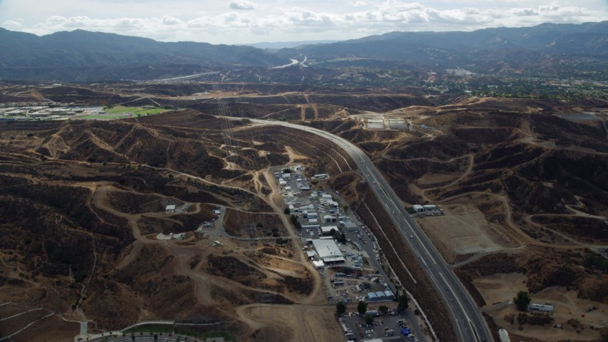 8K stock footage aerial video of a road and warehouses, Santa Clarita, California Aerial Stock Footage   AX0159_049