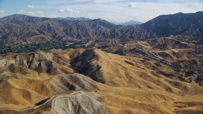 8K stock footage aerial video flying over roads in the hills, Canyon Country Foothills, California Aerial Stock Footage | AX0159_052