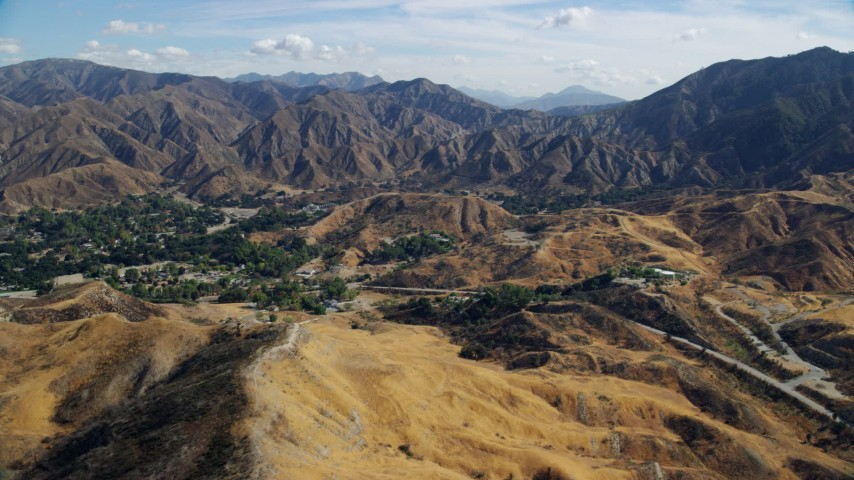 8K stock footage aerial video flying over Canyon Country and houses, California Aerial Stock Footage | AX0159_053