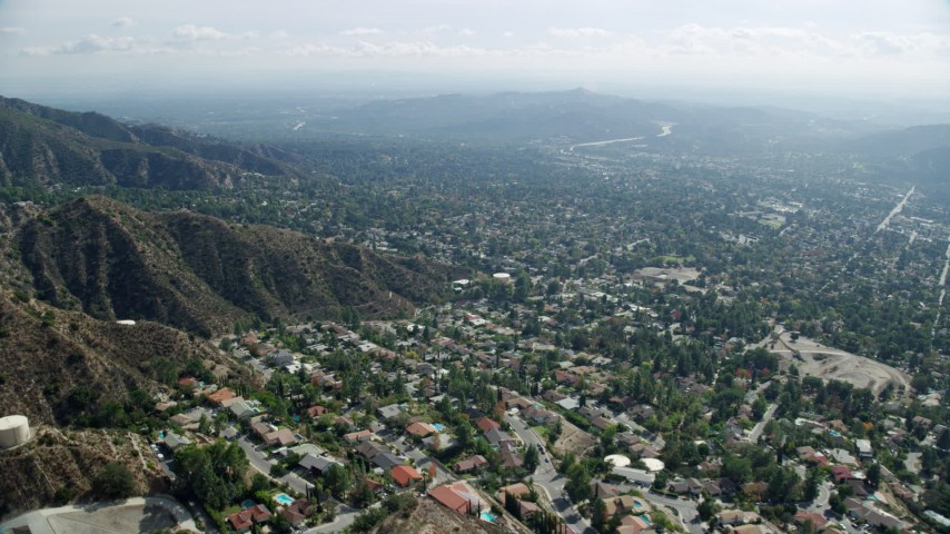 8K stock footage aerial video flying over residential neighborhoods, Tujunga, California Aerial Stock Footage | AX0159_062