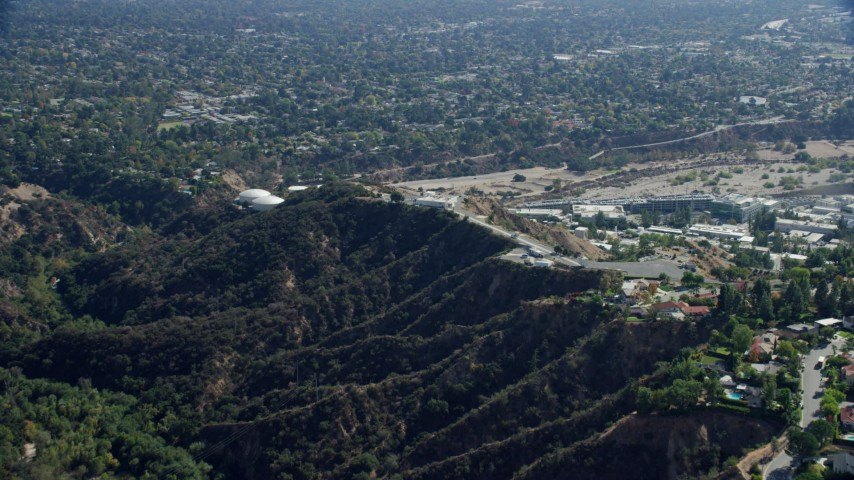 8K stock footage aerial video approaching JPL from behind a mountain ridge, Pasadena, California Aerial Stock Footage | AX0159_066