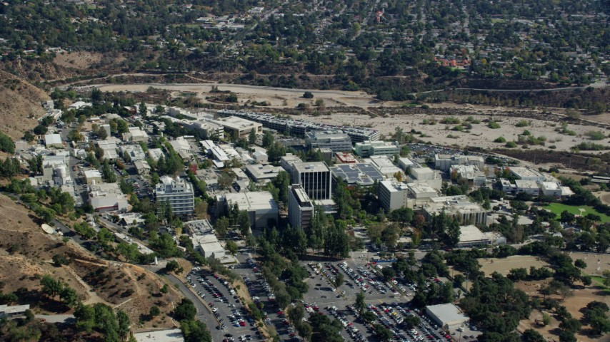 8K stock footage aerial video flying away from research and development center, JPL, Pasadena, California Aerial Stock Footage | AX0159_072
