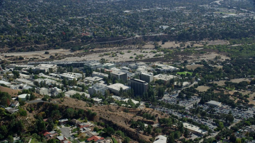 8K stock footage aerial video leaving the research and development campus, JPL, Pasadena, California Aerial Stock Footage | AX0159_073
