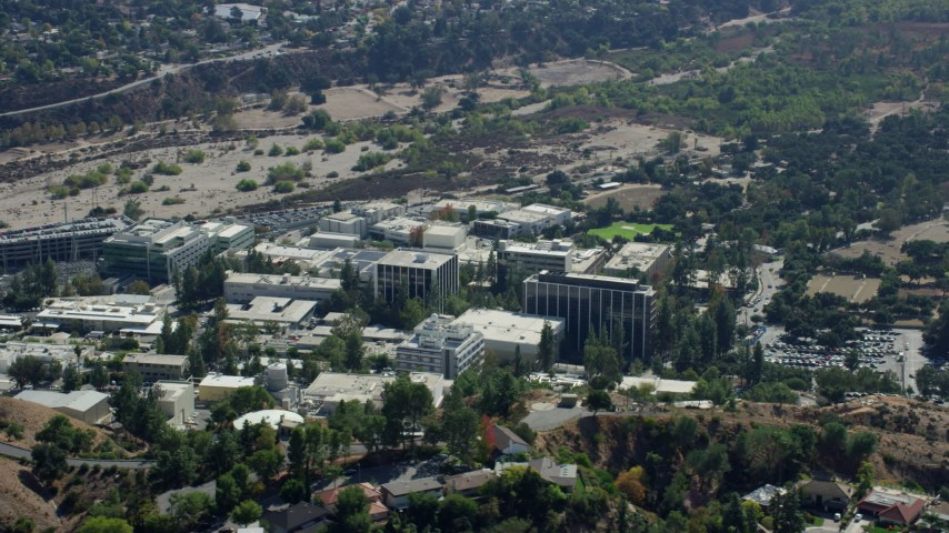 8K stock footage aerial video of a reverse shot of scientific facility buildings, JPL, Pasadena, Caliofrnia Aerial Stock Footage | AX0159_076