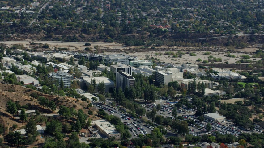 8K stock footage aerial video of parking lot and buildings on campus of JPL, Pasadena, California Aerial Stock Footage AX0159_077 | Axiom Images