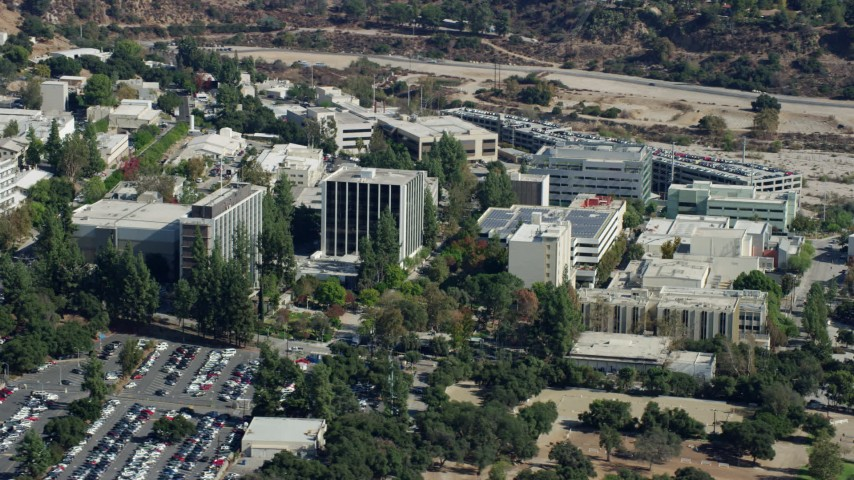 8K stock footage aerial video of parking lot and research and development buildings at JPL, Pasadena, California Aerial Stock Footage | AX0159_078