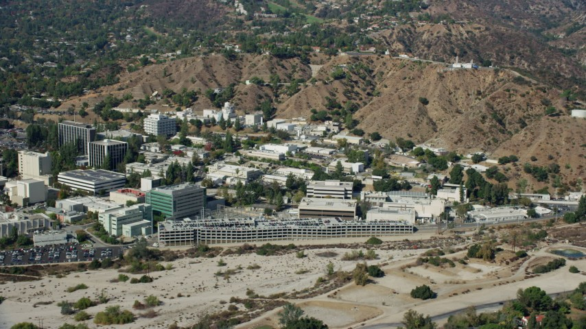 8K stock footage aerial video of the parking garage and research buildings at JPL, Pasadena, California Aerial Stock Footage | AX0159_081