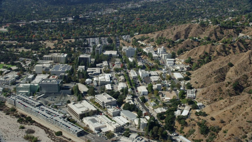 8K stock footage aerial video approaching and flying over research buildings at JPL, Pasadena, California Aerial Stock Footage | AX0159_083