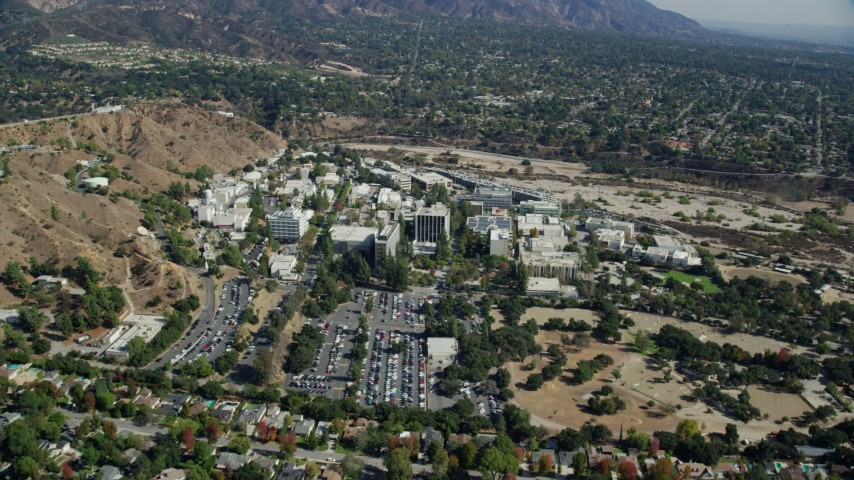 8K stock footage aerial video flying over residential area toward JPL campus, Pasadena, California Aerial Stock Footage | AX0159_085