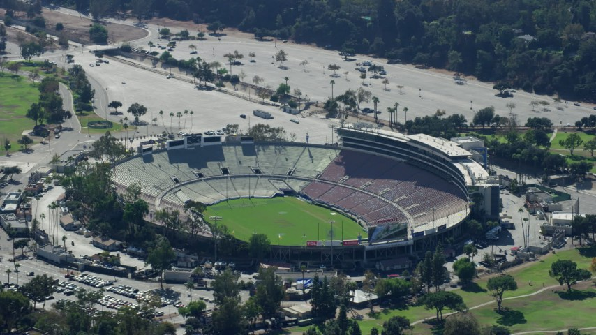 8K stock footage aerial video approaching Rose Bowl Stadium, Pasadena, California Aerial Stock Footage | AX0159_087