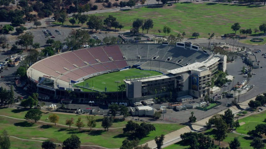 8K stock footage aerial video orbiting Rose Bowl Stadium to the entrance, Pasadena, California Aerial Stock Footage | AX0159_089