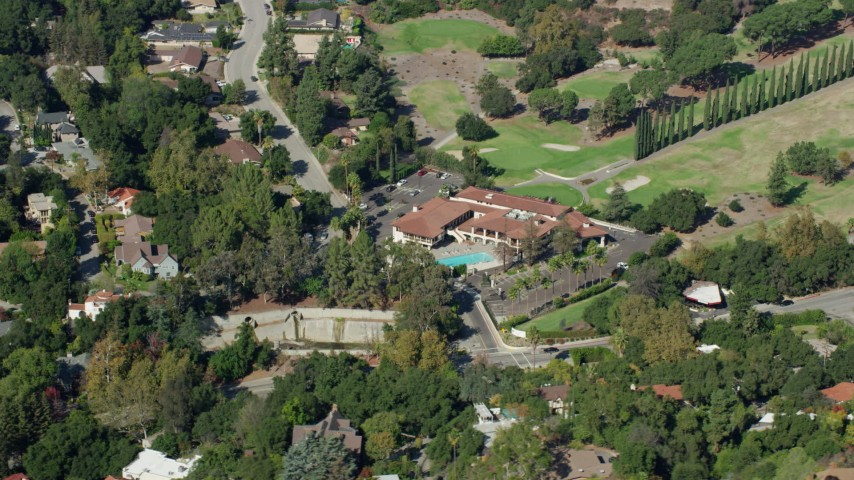 8K stock footage aerial video orbiting Chevy Chase Country Club, Glendale CA Aerial Stock Footage | AX0159_090