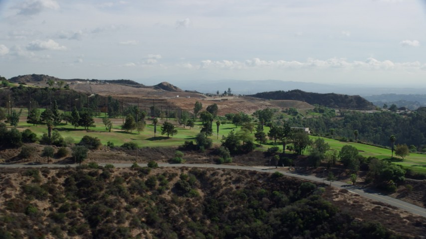 8K stock footage aerial video of a hilltop golf course, Glendale, California Aerial Stock Footage   AX0159_091