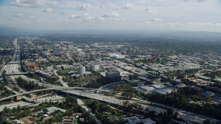 8K stock footage aerial video approaching interchange near office buildings, Pasadena, California Aerial Stock Footage | AX0159_093
