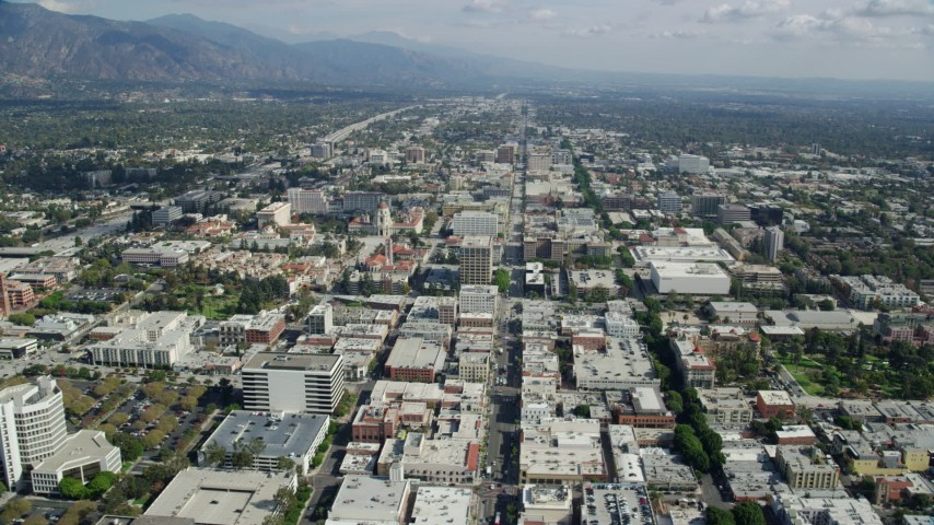 8K stock footage aerial video flying over office buildings and retail areas in Old Pasadena, California Aerial Stock Footage | AX0159_094