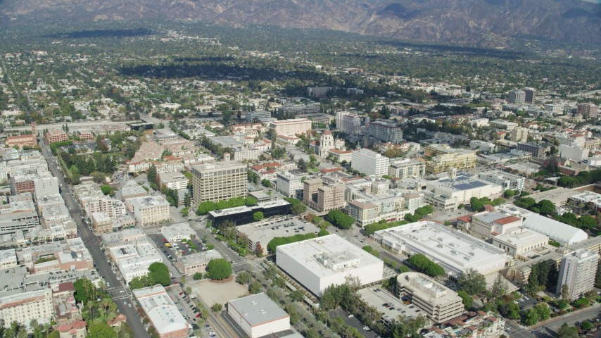 8K stock footage aerial video orbiting downtown office buildings, businesses and shops near City Hall, Pasadena, California Aerial Stock Footage | AX0159_095