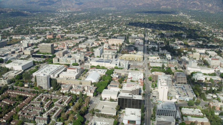 8K stock footage aerial video orbiting away from City Hall and businesses, Pasadena, California Aerial Stock Footage | AX0159_096