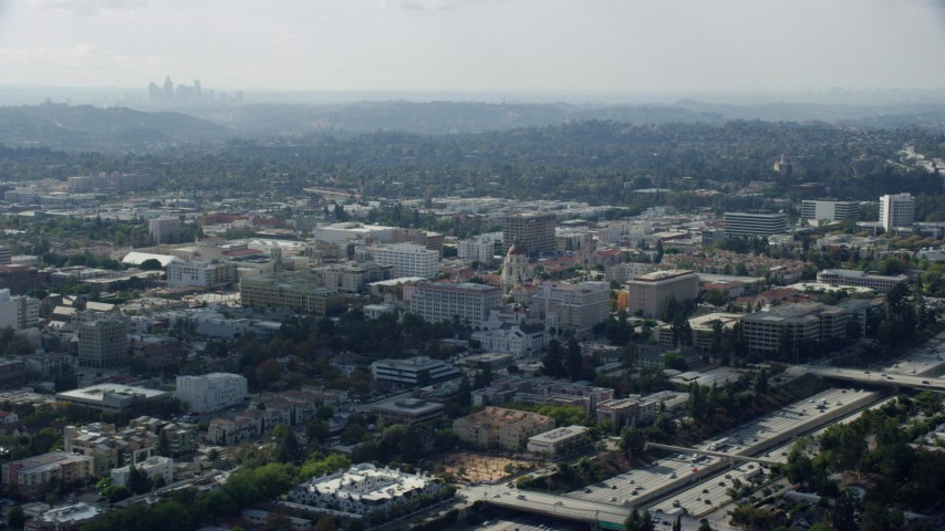 8K stock footage aerial video orbiting Pasadena City Hall and reveal the Downtown Los Angeles skyline, Pasadena, California Aerial Stock Footage | AX0159_099