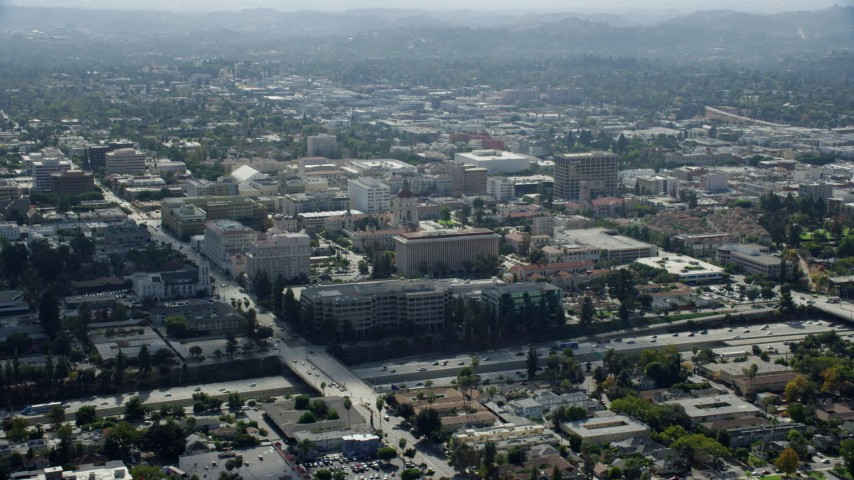 8K stock footage aerial video orbiting Pasadena City Hall and office buildings across the 134 freeway in Pasadena, California Aerial Stock Footage | AX0159_100